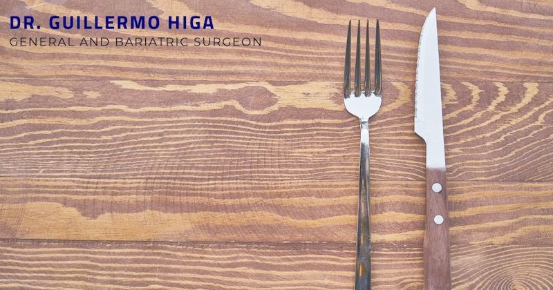 Fork and Knife on a wood grain background