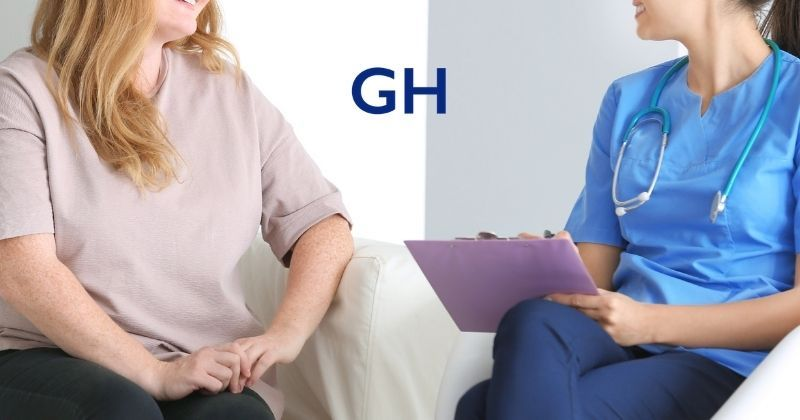 Overweight woman and nurse in scrubs sit discussing cost of weight loss surgery and payment options including insurance and self pay with bariatric surgery financing available. Higa Bariatrics logo at top center.